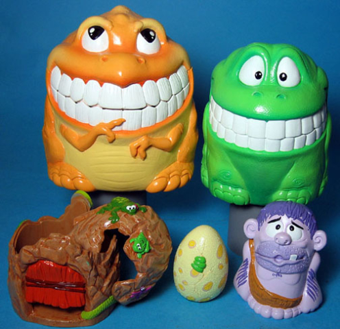 Russian nesting doll Dino set - the egg fits in the caveman fits in the cave fits in the green dino fits in the orange dino
