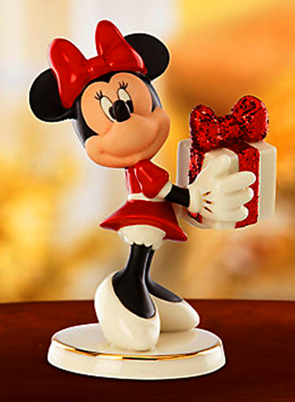 Minnie Mouse holds a glittery gift box Lenox Ceramics Valentines day
