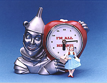 Tin Man Clock shown with really small Dorothy figure with Toto in the basket