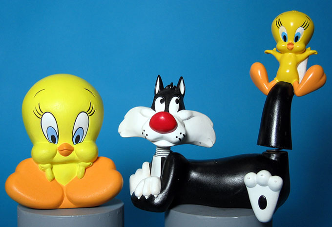 Sitting Tweety and bobblehead Tweety and Sly