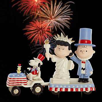 fireworks behind Uncle Sam Charlie Brown, Lady Liberty Lucy and Uncle Sam Snoopy float