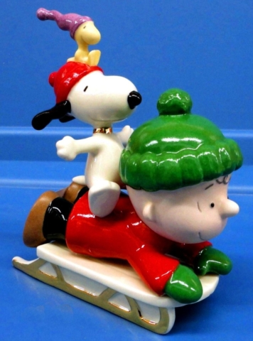Chuck and Snoopy and Woodstock on a sled