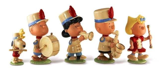 peanuts marching band  - Snoopy with Woodstock on his hat, linus on drums, Lucy on horn, Charlie Brown on sax and Majorette Sally